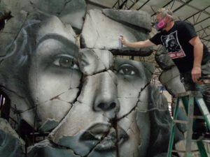 Hope Rises mural with Shane Gammer painting eyes